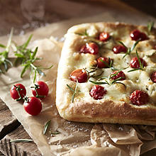 Focaccia with mozzarella, cherry tomatoes and rosemary